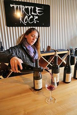 TURTLE ROCK:  Claudia Burns of Turtle Rock Wines pours a splash of small-batch Zinfandel at Paso Underground, an eclectic wine hub hidden in downtown Paso Robles. The family-owned winery creates artisanal wines from fruit sourced from the Willow Creek District. - PHOTO BY DYLAN HONEA-BAUMANN