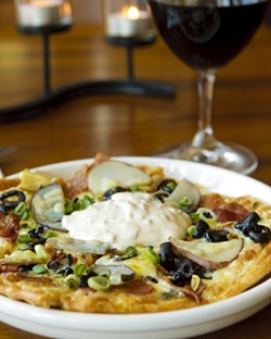 POTATO PIZZA? :  Dishes like baked stuffed potato pizza cleverly meld comfort food and culinary art. - PHOTO BY STEVE E. MILLER