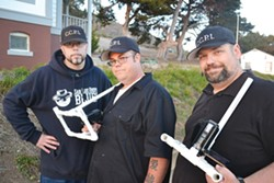 THE CREW:  CCPI founder Mitch Flores (left), senior investigator Micah Watkins (center) and tech coordinator Rob Burr (right) prepare equipment for their paranormal investigation. - PHOTO BY RHYS HEYDEN