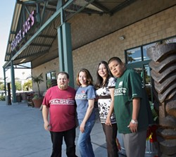 HARDWORKING MEN AND WOMEN :  Aline Graham (center right), who directs PathPoint, and Mariá Méndez (center left), the job coordinator, provide top-notch employees for such area businesses as Trader Joe's. - PHOTO BY MATT FOUNTAIN