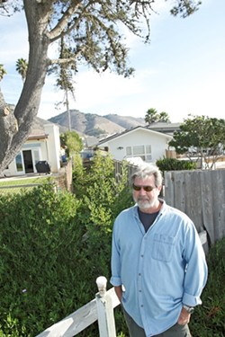 Tim Page wants to reopen a path to the beach that is blocked by a fence and shrubs next to Mark Yandow's Shell Beach home. - PHOTO BY STEVE E. MILLER