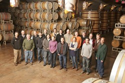COMMON CAUSE :  The Rhone Rangers (pictured here in the Robert Hall Winery caves) come together to promote American Rhone varieties. - PHOTO BY STEVE E. MILLER