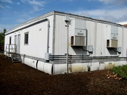 PORTABLE PROBLEMS:  Cuesta's portable buildings are one of the major reasons administrators hope Measure L passes. Due to a state education code, the portables all need to be retired in September 2015, which means more than 60,000 square feet of classrooms and offices need to be replaced in less than a year. - PHOTO COURTESY OF THE CUESTA MAINTENANCE TEAM
