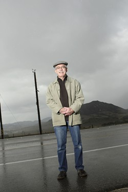 WIND WATCHER:  Paul Allen is a retired county wind expert. He's standing beside one of several wind stations that don't factor into PG&E's emergency plans. - PHOTOS BY STEVE E. MILLER