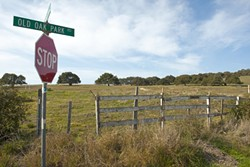 LITTLE PISMO :  If all is planned, this plot of land could be enveloped into the city of Pismo Beach and developed. But locals and some county officials say there aren't enough resources to support the houses, golf course, and convention center developers have planned. - PHOTO BY STEVE E. MILLER