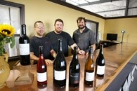 REASON TO SMILE :  Jason Carter (left), the national sales manager and co-owner of Barrel 27 with Mac Myers and Russell From (right) deserves to be merry, considering the raves their value-priced wines have earned. - PHOTO BY STEVE E. MILLER