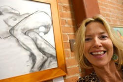 CLOTHING OPTIONAL:  Christine Cortese poses by one of her charcoal drawings in Assets, a studio that teaches barre, as in ballet barre, workouts. The studio is also full of Cortese's figurative oil paintings. - PHOTO BY GLEN STARKEY