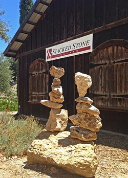 STACKS ON STACKS:  Clarke's signature piece, a heart-shaped rock, can be seen in her rock balances for the appropriately-named Stacked Stone Cellars in Paso Robles. - PHOTO COURTESY OF KATHY CLARKE