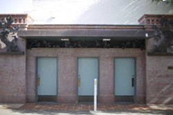 """HA-HA! FAKED YOU OUT!:  SOFCO members were angry at tax dollars building these public restrooms across from Big Sky Café, but find it hilarious when they """"see some tourist waddling over there, squirming to take a whiz,"""" only to find them closed. - PHOTO BY GLEN STARKEY"""