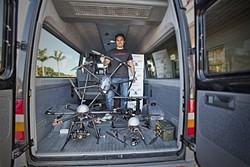 SELLING DRONES:  Jason Lee sells Unmanned Aerial Vehicles (UAVs) for as little as $40 at his shop, Sky Pirate, in Pismo Beach. He believes that the rapid proliferation of drones demonstrates a need for regulations to govern their use. - PHOTO BY DAVID MINSKY
