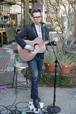 SING OUT, JODY! :  Jody Mulgrew entertained the crowd in the courtyard of the shops at the Garden Shed.