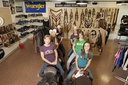 RIDING IN COMFORT :  The Riding Warehouse has everything you need to ride in comfort and a staff happy to help with your selections. Owner Tracy Bailey is pictured with staff. - PHOTO BY STEVE E. MILLER