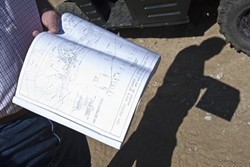 BEST LAID PLANS :  During a previous site tour with Las Pitas Quarry applicant Ken Johnston, he showed early plans for the proposed granite mining and asphalt recycling project. - FILE PHOTO BY STEVE E. MILLER