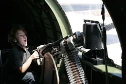 LET'S PRETEND :  Jaden takes aim at imagined German fighter planes from the belly of a B-17.