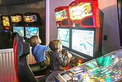 LET'S PLAY:  You don't have to be a kid to enjoy Gino's Pizza's air hockey, pinball, and video games. - PHOTO BY DYLAN HONEA-BAUMANN