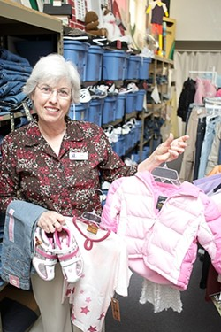 CLOTHING CHILDREN :  Judy Jimenez, Assistance League Philanthropic Vice President, showcases the threads that have clothed over 1,100 children in SLO County through Operation School Bell. - PHOTO BY STEVE E. MILLER