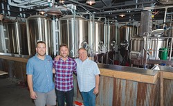 FAMILY TRADITION:  From left, Figueroa Mountain Brewing Co. Arroyo Grande Taproom head brewer David Trailles; founder/owner Jaime Dietenhofer; and his father, brewery owner Jim Dietenhofer, pose for a photo inside their newly constructed taproom opening Father's Day weekend. - PHOTO BY KAORI FUNAHASHI