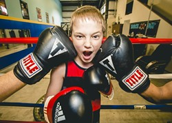 TOUGH CROWD:  A young fighter learns the ins and outs of boxing at Knock Out Boxing Gym in Paso Robles. - PHOTO BY HENRY BRUINGTON