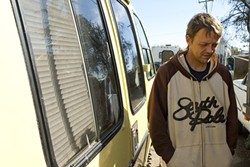 CASHED OUT :  Chad McClure received three tickets in about a week for illegal occupancy. He received a citation after he moved his RV to Prado Road, where people said SLO police told them to go. - PHOTO BY STEVE E. MILLER