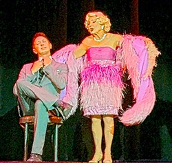 """WHOSE DADDY?:  Dave Hovde is serenaded by feathered and bejeweled Judy, senior Follie, to """"My Heart Belongs to Daddy."""" - PHOTO BY REBECCA LUCAS"""