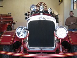THE SEAGRAVE :  San Luis Obispo's adorable first fire engine, restored to pristine condition, will be parked nearby during the opening reception for the exhibit Letters to the Universe at ARTS Space Obispo, located in the SLO Creamery at 570 Higuera St., suite 165, on Aug. 5, from 6 to 9 p.m. - PHOTO COURTESY OF ARTS OBISPO