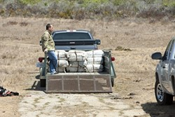 INTRUDERS! :  Several agencies cooperated on investigating a panga beached near San Simeon on Sept. 6. They arrested 20 suspects and seized more than 3,000 pounds of marijuana. More images are available on our Slideshow page. - PHOTOS BY STEVE E. MILLER