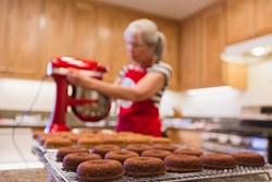 HOMEMADE FOR YOU:  Carol Radike prepares a batch of Doughkies in her home kitchen. Under the Cottage Food Act, Radike started a business selling specialty cookies made at home, instead of in a commercial kitchen. - PHOTO BY KAORI FUNAHASHI