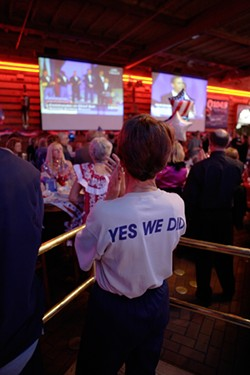 INAUGURAL BALL :  Revelers watch as Obama attends another inaugural ball on the East Coast. - PHOTO BY STEVE E. MILLER