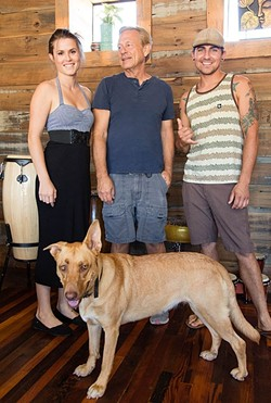 BEHIND THE BEER:  From left, Bang the Drum Director of Marketing Noelle DuBois, father and Bang the Drum Brewery President Gary DuBois, and Head Brewer Jeremy Edward Fleming on deck at the new beer hangout located on Orcutt Road in SLO. Brewery dog Lyra is wondering where her pint is. - PHOTO BY TOM FALCONER