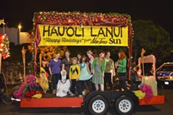 PEANUTS GALLERY:  The entire group congregates on our grand float minutes before our imminent demise. Er … I mean, our dancing debut. - PHOTO BY ALEX ZUNIGA