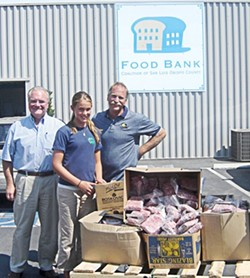 SUSTENANCE :  Volunteer Christine Allen, Food Bank Executive Director Carl Hansen (left), and Food Bank Warehouse Manager Stan Schecter coordinate the distribution of high-protein meals thanks to donations arranged through 4-H. - PHOTO BY DEBBIE ALLEN