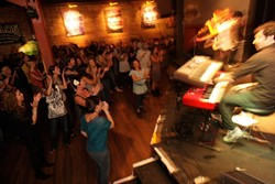 THE CROWD LOVES 'EM! :  About 300 fans packed into Downtown Brew last Saturday to see the Damon Castillo Band take top honors as Best Band. - PHOTO BY STEVE E. MILLER