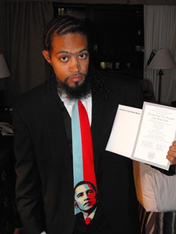 SANTA MARIA TO WASHINGTON, D.C.:  Marcus King is vice-president of Allan Hancock College's Associated Student Body Government. Here, he's holding the inaugural tickets he received from U.S. Rep. Lois Capps'office. - PHOTO BY JEFF HAMSHER