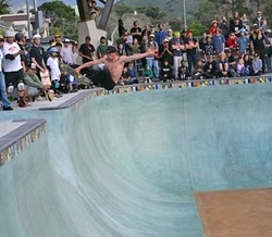 BIG AIR!:  Some fearless pro skaters showed the crowd how it was done in the park's biggest bowl during the grand opening on Feb. 28. - PHOTO BY GLEN STARKEY