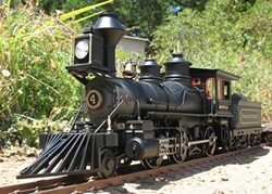 RIGHT ON TIME :  A No. 4 Baldwin Locomotive Works steam engine rides its tiny tracks in down-to-the-rivet detailed glory. - PHOTO BY DENNIS PEARSON