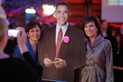 INAUGURAL BALL :  Simone Viola (right) and Pirtza Abuan (left) pose with President Obama's cutout at The Graduate. - PHOTO BY STEVE E. MILLER