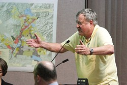 I'LL GIVE YOU FOUR! :  Jim Duenow offers to beat Copeland's offer for a piece of land by almost $3 million at the July, 1 city council meeting. And, he'll pay for parking. - PHOTO BY STEVE E. MILLER