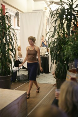 RUN, FOREST, RUN! :  Cal Poly models sprint along the runway during a sustainable fashion show. - PHOTO BY GLEN STARKEY