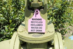 FINE FOR WINE? :  Warnings such as this one adorn areas where SLO City irrigates with recycled water. - PHOTO BY STEVE E. MILLER