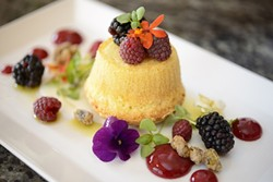 BERRY DELICIOUS:  Desserts at Willow include this olive oil cake with goat cheese coulis, raspberry gel, local fresh berries, braised pistachio, micro herbs, and edible flowers. - PHOTO BY STEVE E. MILLER