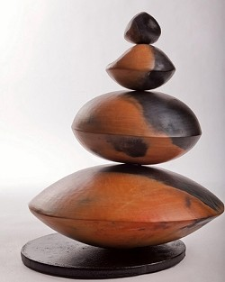 """EQUILIBRIO AUTUNNO :  The organic forms crafted by Swiss Italian sculptor Simona Bellini harmonize elegantly with di Santo's nature-inspired watercolors in the Steynberg Gallery exhibit """"Stagioni,"""" Italian for """"Seasons."""" - ART BY SIMONA BELLINI, PHOTO COURTESY OF STEYNBERG GALLERY"""