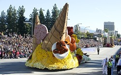 BYE-BYE, PASADENA!:  Cal Poly universities' float makes its way down the 5.5-mile parade route with a gummy bear waving goodbye to about 700,000 live spectators. - PHOTO BY TOM ZASADZINSKI; COURTESY OF CAL POLY SLO & POMONA