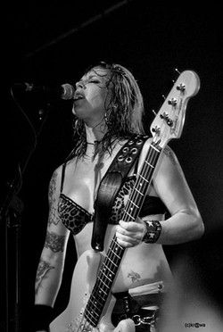 SHE'S A PUSSY:  Nashville Pussy bassist Karen Cuda will provide the sights and sounds at Pozo Saloon's four-band rock'n'roll extravaganza this July 4 that also includes music by Sexy Time Explosion, The Supersuckers, and headliners The Reverend Horton Heat. - PHOTO BY KR@WA