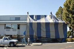 TARP-E DIEM:  A team of six workers from Coastal Fumigation, a Santa Maria-based pest-control company, worked to tent and fumigate the Blue Sail Inn in Morro Bay on Dec. 4. - PHOTO BY STEVE E. MILLER