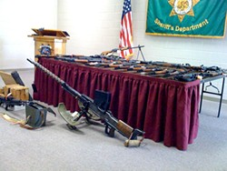 KRINSKY'S COLLECTION :  While searching for Alan Garrison, who skipped a court date when faced with several weapons charges, local law enforcement stumbled on 209 guns in Howard Krinsky's Arroyo Grande home. - PHOTO BY COLIN RIGLEY