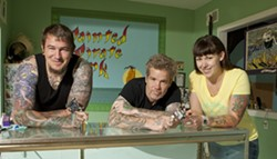 POLLY WANT SOME SKIN ART? :  After an eight-year search, Bob McNure (center) and his wife, Claire Gorrindo (right), were able to open up their own tattoo shop, Painted Pirate Ink in Morro Bay. Along with Jeremiah Adams (left), they're still putting the finishing touches on the shop, but clients are already welcome. - PHOTO BY STEVE E. MILLER