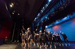 ARMS WIDE OPEN:  The Orchesis Dance Company members rehearse their finale number, set to the music of Mumford & Sons and choreographed by guest artist Mike Esperanza. - PHOTO BY KAORI FUNAHASHI