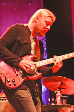 DEREK TRUCKS:  Using a glass slide, Derek Trucks lit up the night with his amazing guitar work. - PHOTO BY ANNA STARKEY