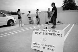 PDA :  One of the stops along the way for Portable Dance Assembly was the top level of the Marsh Street parking garage, where the dancers performed while cars drove by. - PHOTO BY STEVE E. MILLER