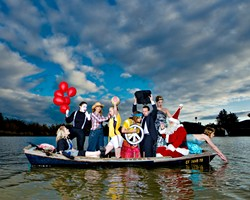 ALL IN THE SAME BOAT :  (DOUBLE TAKE) (l-r) Christy Heron ('50s housewife), Amy Asman (mime), Chloe Rucker (farmer), Ellie Cattaneo (soccer player), Kristina Bennett (hippie), Brent Staple (businessman), Dora Mountain (beauty queen), Ed Connolly (Santa), and Heather Weltner (mermaid). Art director: Ashley Schwellenbach. Hair and makeup by Shelby Hood. Boat (the Mudhen) courtesy of Glen Starkey. - PHOTO BY STEVE E. MILLER